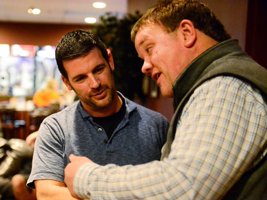 Tony Taylor, left, who lost his seat on Fremont City Council, discusses Tuesday's election with fellow Republican Justin Smith, who holds a two-vote lead for Fremont City Council's First Ward seat, at Plaza Lanes in Fremont.