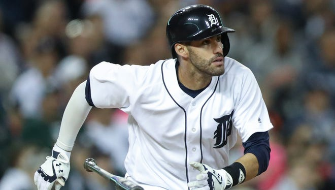 Tigers rightfielder J.D. Martinez hits a two-run homer during second inning Monday at Comerica Park.