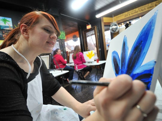 Jen Tessmer of Wausau works on her artwork during a painting class Wednesday at U Paint & Party in Wausau.