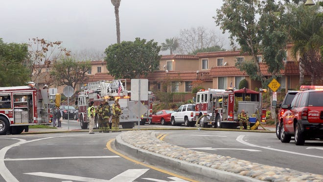 Firefighters fight a blaze at an condominium complex in the 26000 block of La Zanja Street in San Juan Capistrano, Calif., Tuesday, Jan. 20, 2015.