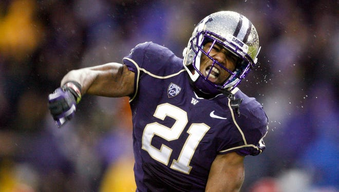 Washington defensive back Marcus Peters (21) reacts to a fourth down stop against Arizona during the fourth quarter of a victory Saturday at Husky Stadium.