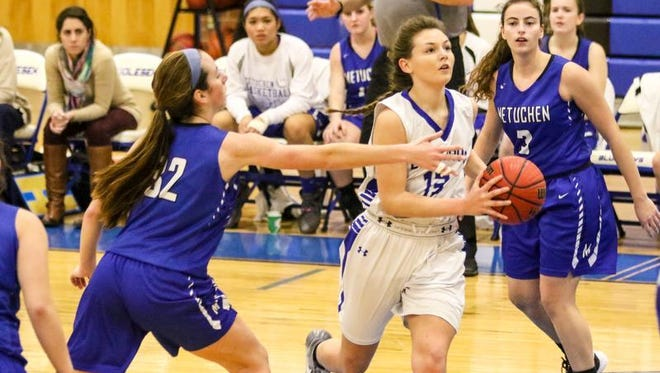 Middlesex's Moira Phillips goes to the basket as Metuchen defends during the first half on Wednesday at Middlesex High School.