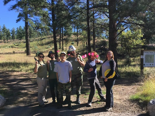 EcoServants volunteer to help build trails on public