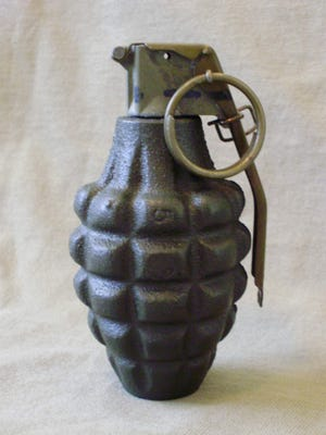 A dummy version of a pineapple type hand grenade