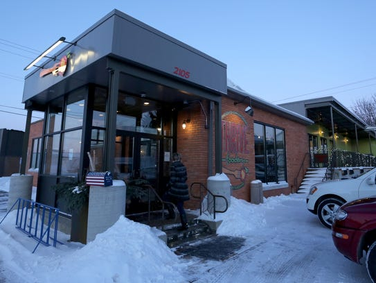 A woman enters Thrive Foodery in Wausau, Friday, January