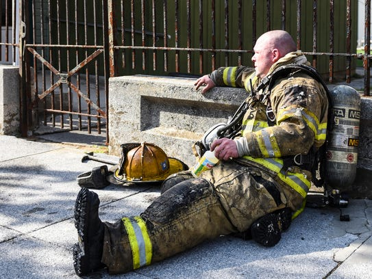 A three-alarm fire heavily damaged two homes in the