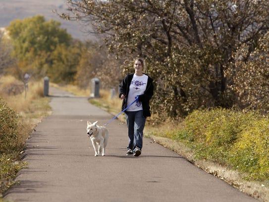 Chantelle Miller walks her dog, Sunshine, along the