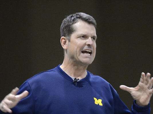 635583972920789989-harbaugh-coaches-clinic-1