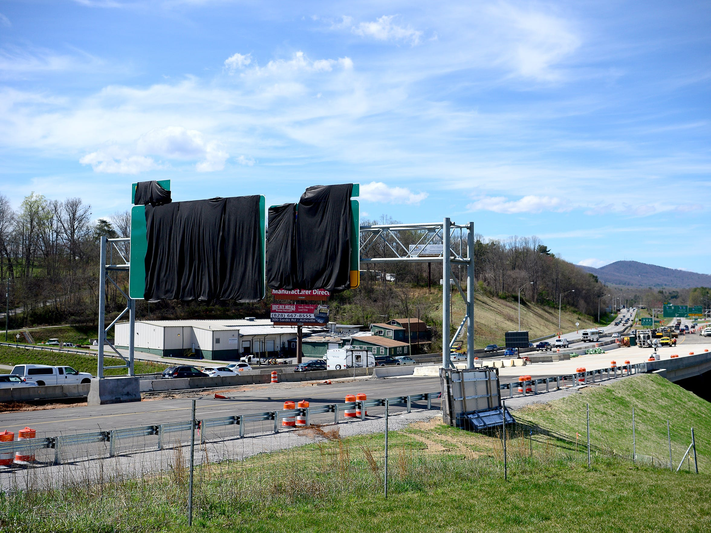 New road signs is covered with a black tarp over the under-construction portion of I-26 at Pond Road on April 4.