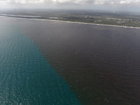 Dirty water from the Indian River Lagoon empties into