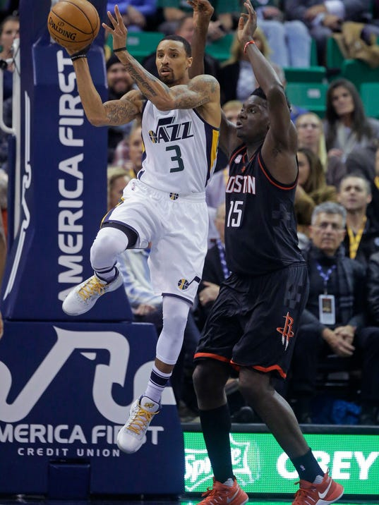 Utah Jazz guard George Hill (3) passes the ball as Houston Rockets center Clint Capela (15) defends in the first half of an NBA basketball game Tuesday, Nov. 29, 2016, in Salt Lake City. (AP Photo/Rick Bowmer)