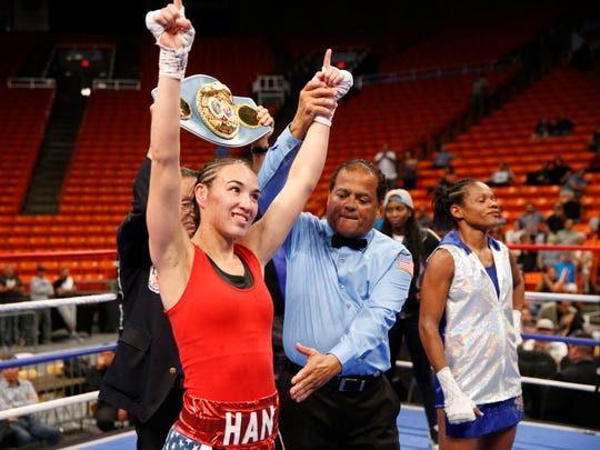 Jennifer han gets her hand lifted as she was pronounced the winner and retains her IBF World Featherweight title with a unamimous decision over Liliana Martinez at the Don Haskins Center.