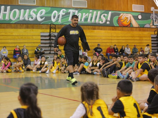 Jose Gil works with kids at the Gil Basketball Academy.
