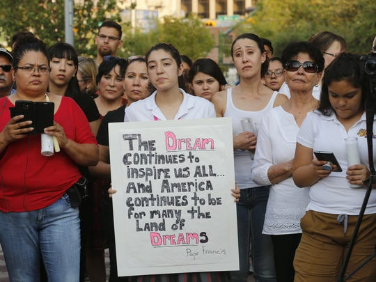 A candle light vigil was held in early September at San Jacinto Plaza to protest President Trump's action ending the DACA program.