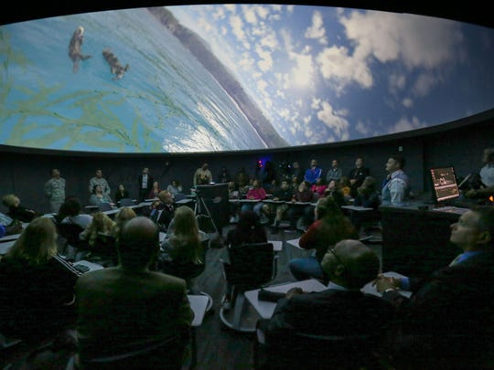 Students at McCullough Middle School in New Castle watch a presentation in their new planetarium during a media tour Thursday.