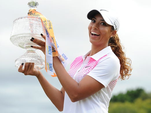Cheyenne Woods holds the winners trophy after day four of the 2014 Australian Ladies Masters.