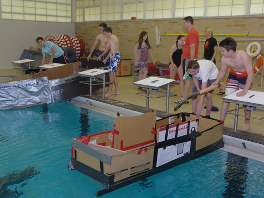 Students get ready to launch their duct tape boats in the pool.