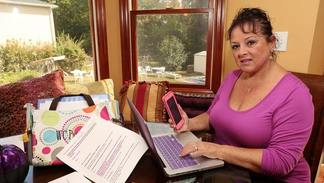 Marie Sullivan, seen at home in Paramus, gets exhausted trying to keep up with social media and all that goes with it on her phone and laptop.