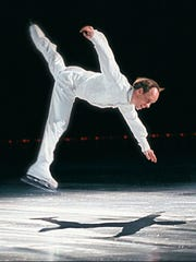 Scott Hamilton performs during the opening number of