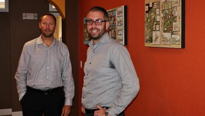 Brian Smith, left, and Jonathan Romine of EnSite Inc., an engineering and planning company in Fort Myers.