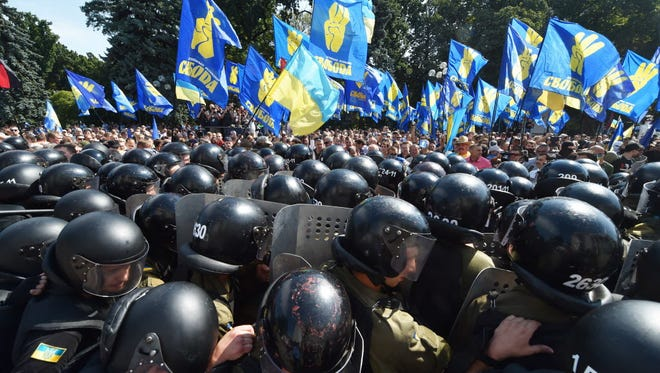 Activists of a few radical Ukrainian parties clash with police officers in front of the parliament in Kiev on Aug. 31, 2015.