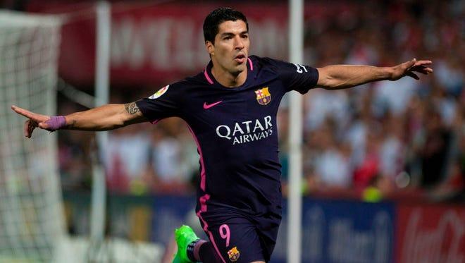 Luis Suarez celebrates after scoring against Granada FC.