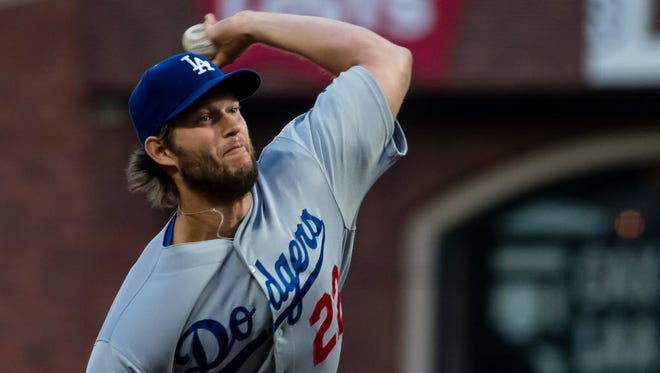 Dodgers starting pitcher Clayton Kershaw pitches against the Giants during the first inning at AT&T Park in San Francisco.