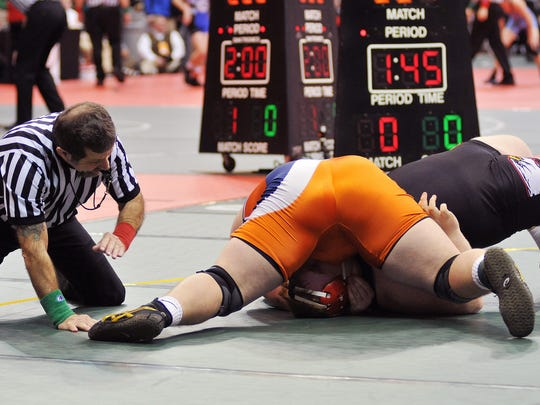 Galion's Deaken McCoy goes for the pin against Middletown Bishop's Ryan Fessler in the 285lbs class at State Championships in Columbus Thursday.