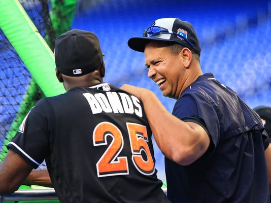 New York Yankees designated hitter Alex Rodriguez, right, talks with Miami Marlins hitting coach Barry Bonds before an exhibition baseball game on Friday, April 1, 2016, in Miami, Fla. (AP Photo/Rob Foldy)