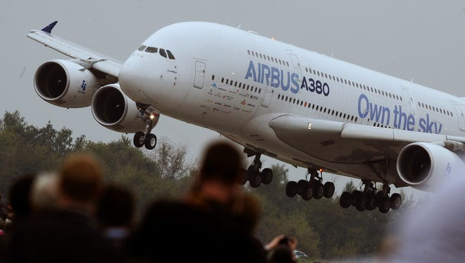 Visitors watch a Airbus A380 landing at the MAKS Air Show in Zhukovsky outside Moscow on Aug. 30, 2013.