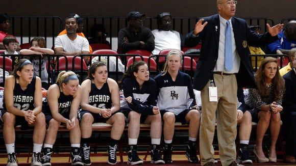Bishop McGuinness and coach Brian Robinson won nine straight NCHSAA 1-A girls basketball championships.