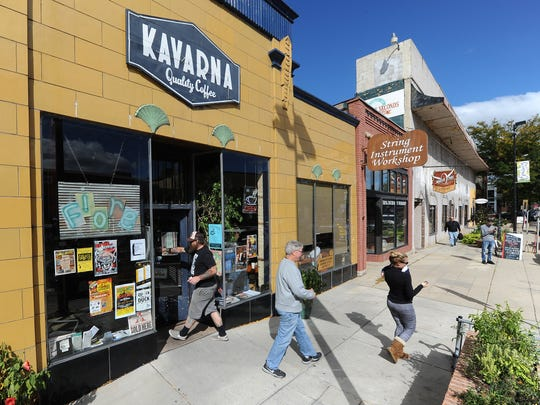 Broadway District stores are eclectic and varied in the products and services they offer. One of the consistently busy stores is Kavarna Coffeehouse shown on Broadway in Green Bay October 2, 2015.