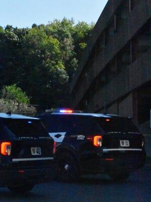 Utica Police Department officers investigate Saturday, September 19, 2020, near a parking garage on the St. Elizabeth Medical Center campus in Utica.