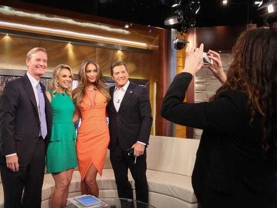 "Steve Doocy, left, Elisabeth Hasselbeck, Hannah Davis and Eric Bolling appear on ""Fox & Friends"" on Feb. 10, 2015, in New York City."