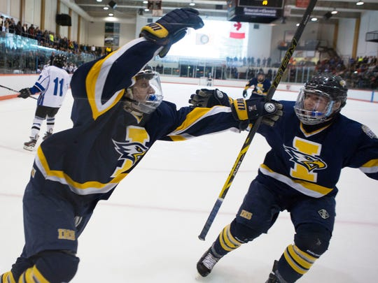 Irondequoit's Phillip Barilla celebrates with teammate Daniel Dugauy after scoring their second goal against Brockport in a Section V Class B Final game in RIT's Ritter Arena on Sunday, March 1, 2015.