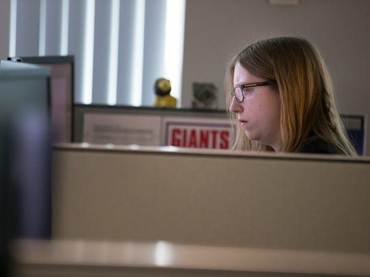 Tactical Analyst Christy Olson works in the Monroe Crime Analysis Center in the Rochester Public Safety Building.