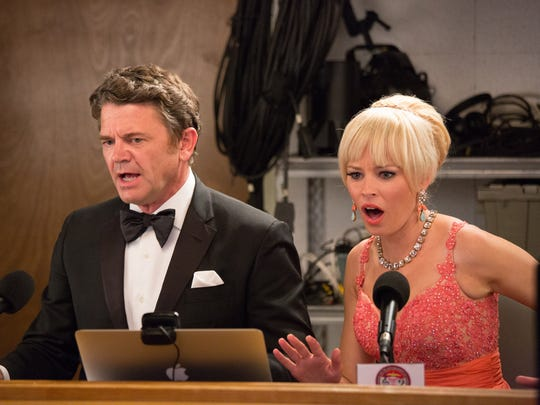 "This photo released by Universal Pictures shows John Michael Higgins, left, as John, and Elizabeth Banks as Gail, shocked by Barden Bellas' behavior in a scene from the film, ""Pitch Perfect 2."""