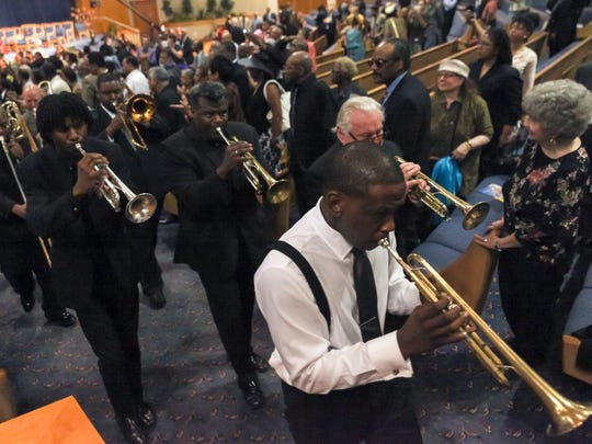 "A New Orleans style funeral procession to the tune of ""When the Saints Go Marching In"" marked the close of the public funeral services for jazz trumpeter Marcus Belgrave at Greater Grace Temple in Detroit on Saturday, May 30, 2015."