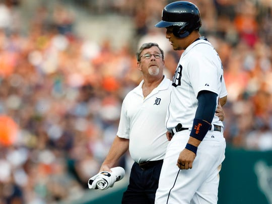 Jul 3, 2015; Detroit, MI, USA; Detroit Tigers first baseman Miguel Cabrera (24) is helped off the field by trainer Kevin Rand after getting injured in the fourth inning against the Toronto Blue Jays at Comerica Park. Mandatory Credit: Rick Osentoski-USA TODAY Sports