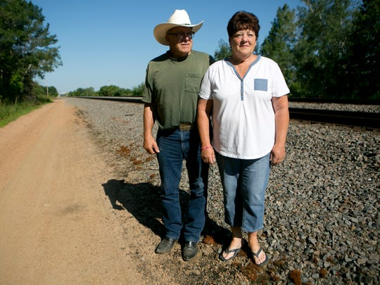 Jim and Barb Vitort of Junction City say trains have blocked access to their home during emergencies, prompting them to build a private frontage road.