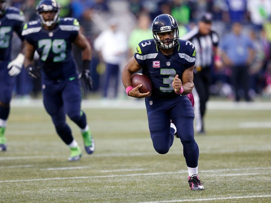 Seahawks quarterback Russell Wilson runs with the ball