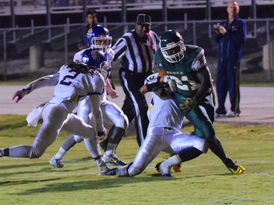 Berea's Stevie Williams(21) drives for yardage