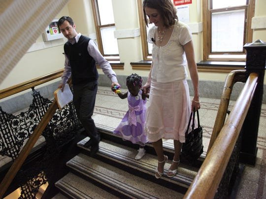Maya, Mandy, and Matt leave the Marion County Courthouse after the adoption of Maya.