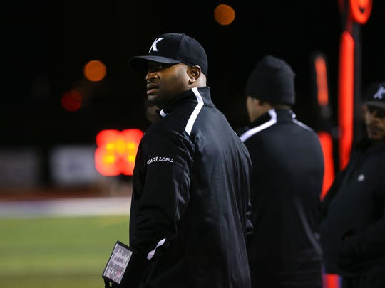 Bishop Kearney Head Coach Eddie Long glances up at the scoreboard during the Class D state semifinal game at Cicero-North Syracuse High School on Friday, November 20, 2015.