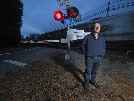 Alan Brody, the husband of Ellen Brody, the driver whose vehicle was struck by a Metro-North train in Valhalla in February 2015, stands at the Commerce Street crossing. Ellen Brody's Mercedes SUV was struck at this crossing after she drove into the path of the oncoming train. Brody and five train passengers were killed. Alan Brody has taken up the issue of improving railroad crossing safety.