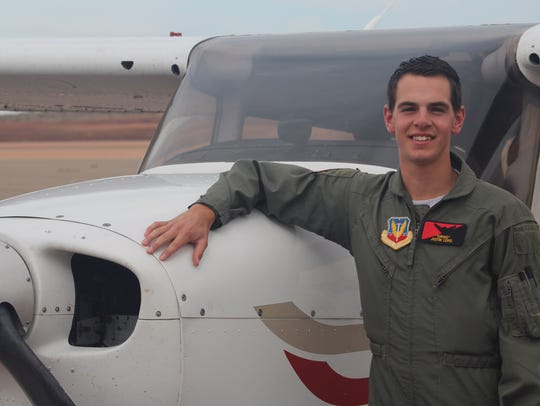 Justin Lewis poses with a plane May 20 after soloing