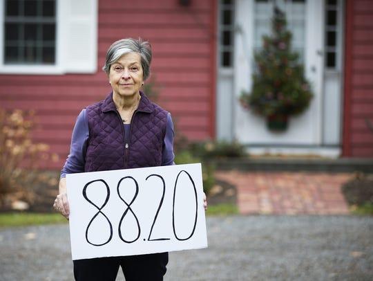 Webster resident Deb Oakley pays $88.20 per quarter