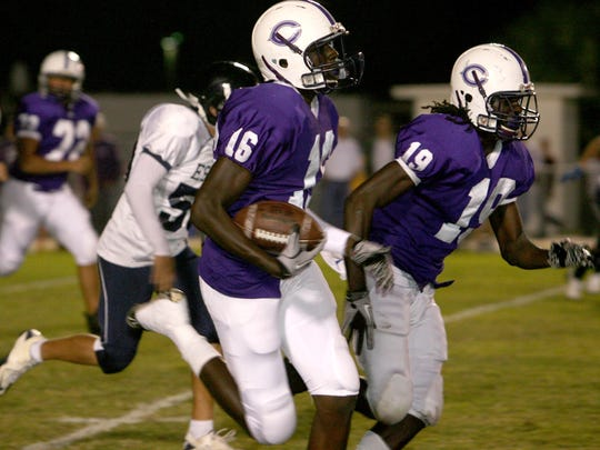 Cypress Lake's Jayron Kearse gets blocking from De'Vondre Campbell in a game from 2010.