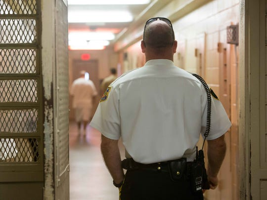 Correctional Lt. Brian Reynolds stands guard in September