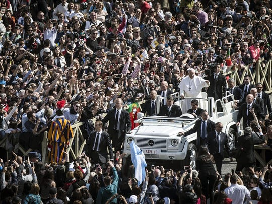 Pope Francis greets faithful after Easter Mass.